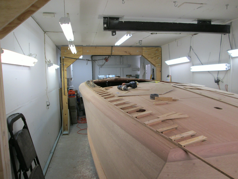Rear starboard view of router jig in place with the outside deck seam routed.