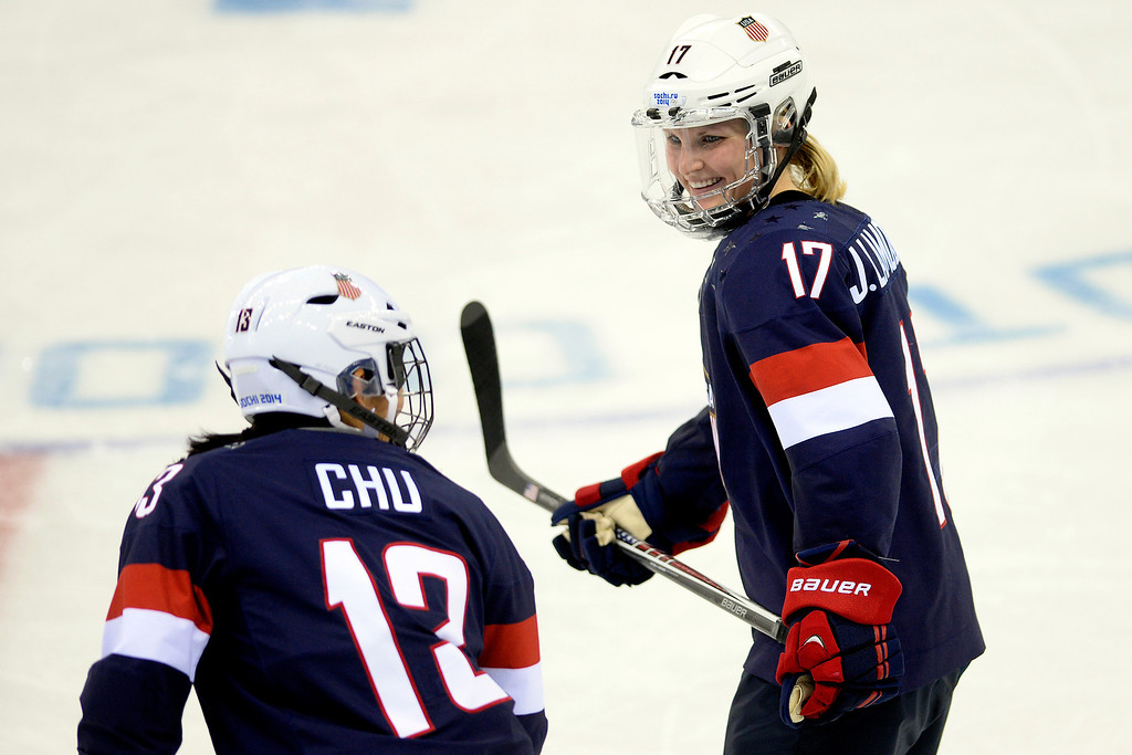 . Jocelyne Lamoureaux (17) of the U.S.A. and Julie Chu (13) of the U.S.A. joke during the third period of the United States\' 9-0 win at the Shayba Arena. Sochi 2014 Winter Olympics on Monday, February 10, 2014. (Photo by AAron Ontiveroz/The Denver Post)
