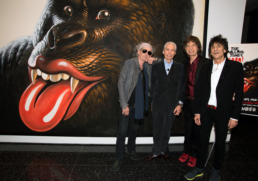". This Nov. 14, 2012 photo released by the Museum of Modern Art shows members of The Rolling Stones, from left, Keith Richards, Charlie Watts, Mick Jagger and Ronnie Wood standing in front of artwork by Walton Ford at the Museum of Modern Art in New York. The artwork, which the cover art for the band\'s latest album, ""Grrr!,\"" was on display at the museum for a retrospective for the band\'s 50th anniversary.   (AP Photo/MoMA, Scott Rudd)"