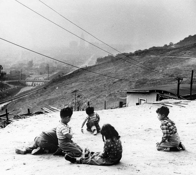 Children Playing on Top of a Hill