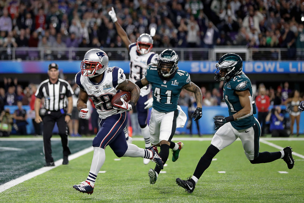 . New England Patriots\' James White runs for a touchdown during the first half of the NFL Super Bowl 52 football game against the Philadelphia Eagles Sunday, Feb. 4, 2018, in Minneapolis. (AP Photo/Mark Humphrey)