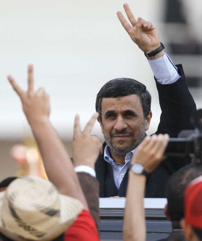 . Iran\'s President Mahmoud Ahmadinejad makes a victory sign after attending the funeral ceremony for Venezuela\'s late President Hugo Chavez at the military academy in Caracas, Venezuela, Friday, March 8, 2013.   (AP Photo/Fernando Llano)