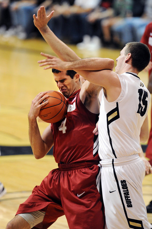. Stefan Nastic, left, of Stanford is fouled by Shane Harris-Tunks of Colorado, during the first half of the January 24th, 2013 game in Boulder. Cliff Grassmick / January 24, 2013