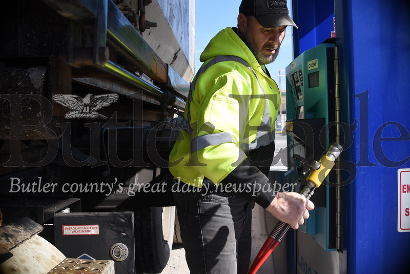 Randy Russell of Beaver Falls drives one of about 30 garbage trucks fueled by compressed gas drawn off the garbage inside Seneca Landfill. The landfill won a governor's award for environmental excellence last week for the fueling system. Tanner Cole/Butler Eagle