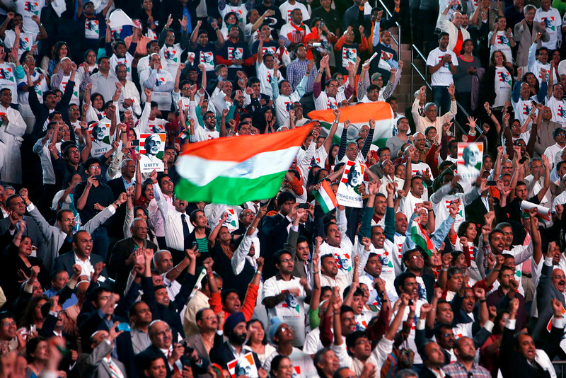 . Supporters cheers and wave Indian flags as India\'s Prime Minister Narendra Modi gives a speech during a reception by the Indian community in honor of his visit to the United States at Madison Square Garden, Sunday, Sept. 28, 2014, in New York. (AP Photo/Jason DeCrow)