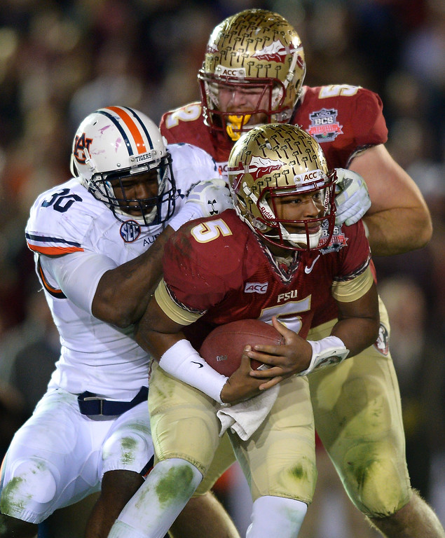 . Auburn\'s Dee Ford sacks Florida State QB Jameis Winston in the second half of the BCS national championship game at the Rose Bowl, Monday, January 6, 2014. (Photo by Michael Owen Baker/L.A. Daily News)