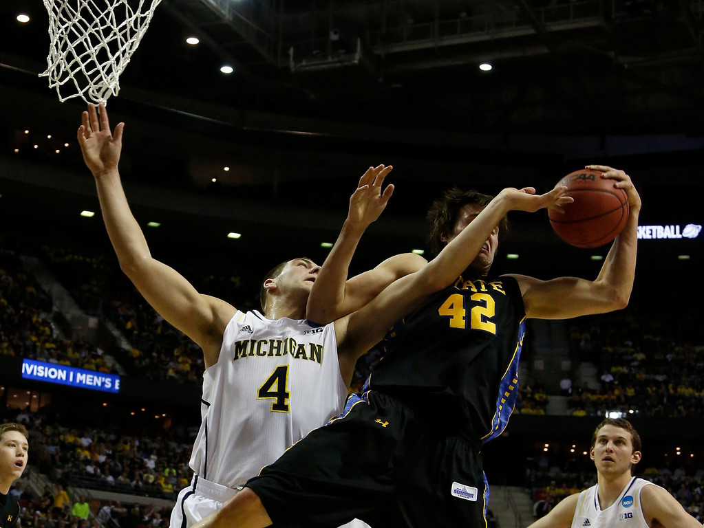 . Michigan Wolverines\' Mitch McGary fights for a rebound against South Dakota State\'s Jordan Dykstra during first-half action in the men\'s NCAA basketball tournament at The Palace of Auburn Hills in Auburn Hills, Michigan, Thursday, March 21, 2013. (Julian H. Gonzalez/Detroit Free Press/MCT)