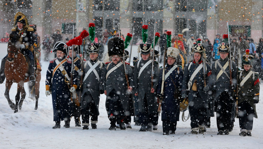 . Historical re-enactors dressed as 1812-era French soldiers march during a reenactment of the French Invasion of Russia in 1812, during celebrations to mark the Russian Orthodox Christmas in St. Petersburg, Russia, Monday, Jan. 7, 2013.  Christmas falls on Jan. 7 for Orthodox Christians who rely on the old Julian calendar rather than the  Gregorian calendar adopted by Catholics and Protestants and commonly used in secular life around the world. (AP Photo/Dmitry Lovetsky)