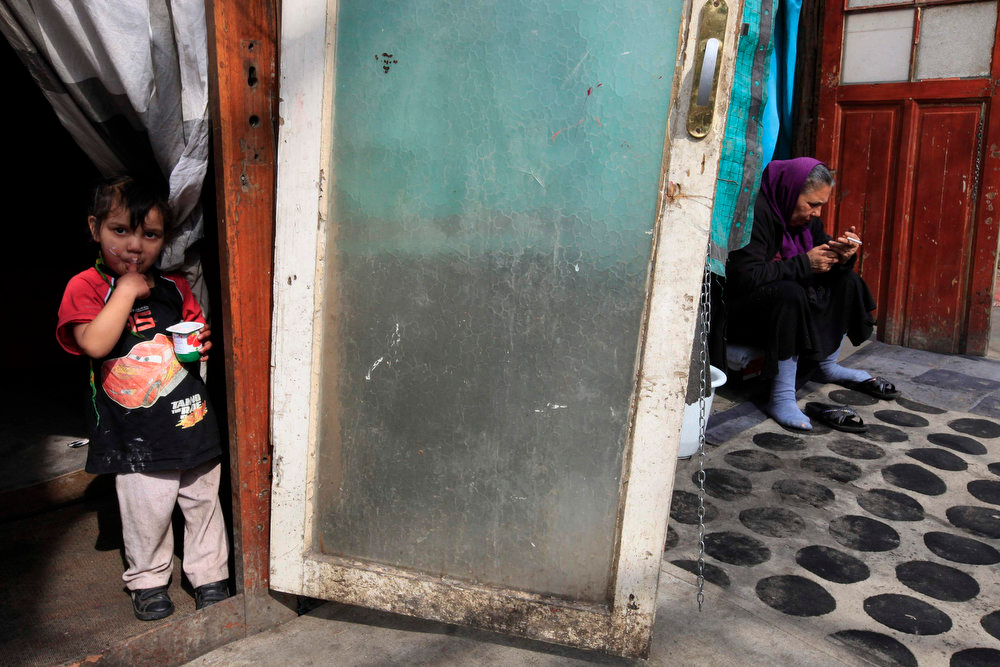 . A young Roma child stands in the doorway of a shelter in an illegal camp in Lille, northern France during International Roma Day on April 8, 2013.   REUTERS/Pascal Rossignol