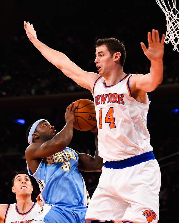 . NEW YORK, NY - NOVEMBER 16: Ty Lawson #3 of the Denver Nuggets attempts a shot under Jason Smith #14 of the New York Knicks in the first half at Madison Square Garden on November 16, 2014 in New York City. NOTE TO USER: User expressly acknowledges and agrees that, by downloading and/or using this photograph, user is consenting to the terms and conditions of the Getty Images License Agreement.  (Photo by Alex Goodlett/Getty Images)