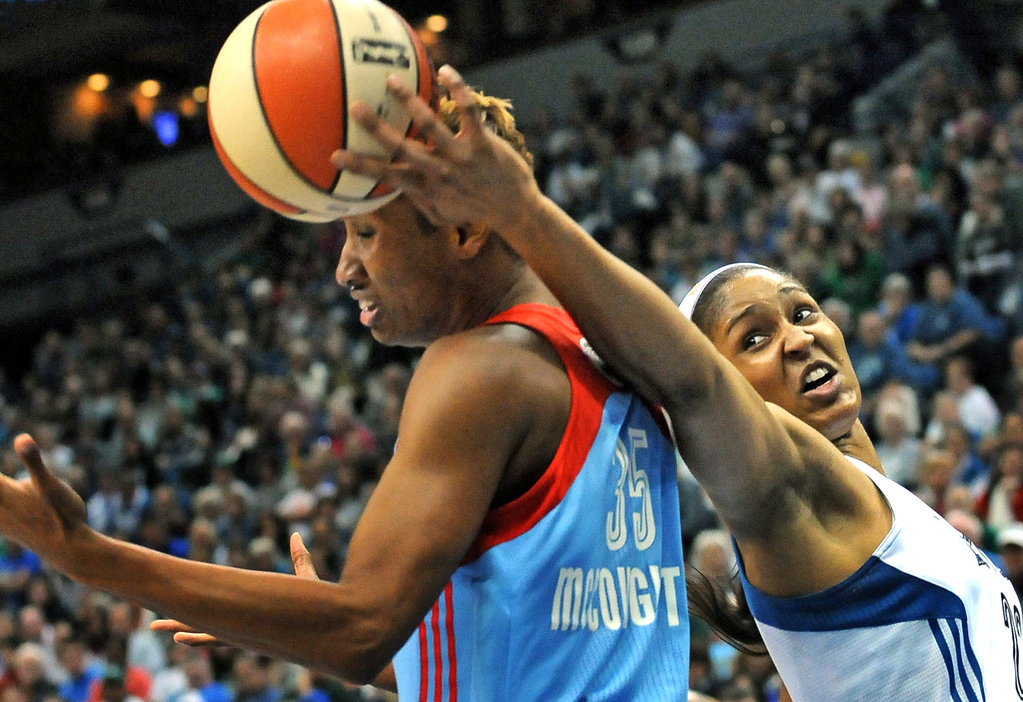 . Minnesota\'s Maya Moore, right, reaches for a rebound as Atlanta\'s Angel McCoughtry looks for the ball during the first quarter. (Pioneer Press: Sherri LaRose-Chiglo)