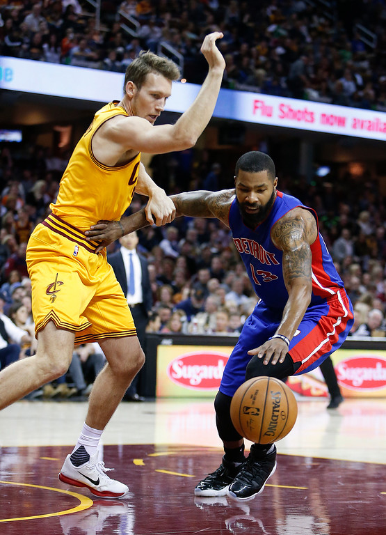 . Detroit Pistons\' Marcus Morris (13) battles Cleveland Cavaliers\' Mike Dunleavy (3) for a loose ball during the second half of an NBA basketball game Friday, Nov. 18, 2016, in Cleveland. The Cavaliers won 104-81. (AP Photo/Ron Schwane)