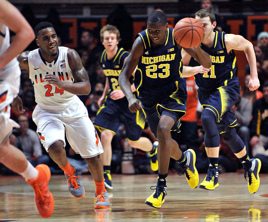 . Michigan guard Caris LeVert (23) runs on a fast break ahead of Illinois guard Rayvonte Rice (24) duirng the second half of an NCAA college basketball game Tuesday, March 4, 2014, in Champaign, Ill. Michigan won 84-53. (AP Photo/Rick Danzl)