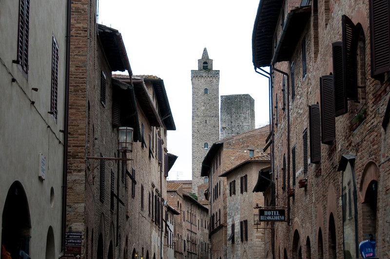 View of tower in San Gimignano from a street - Italy