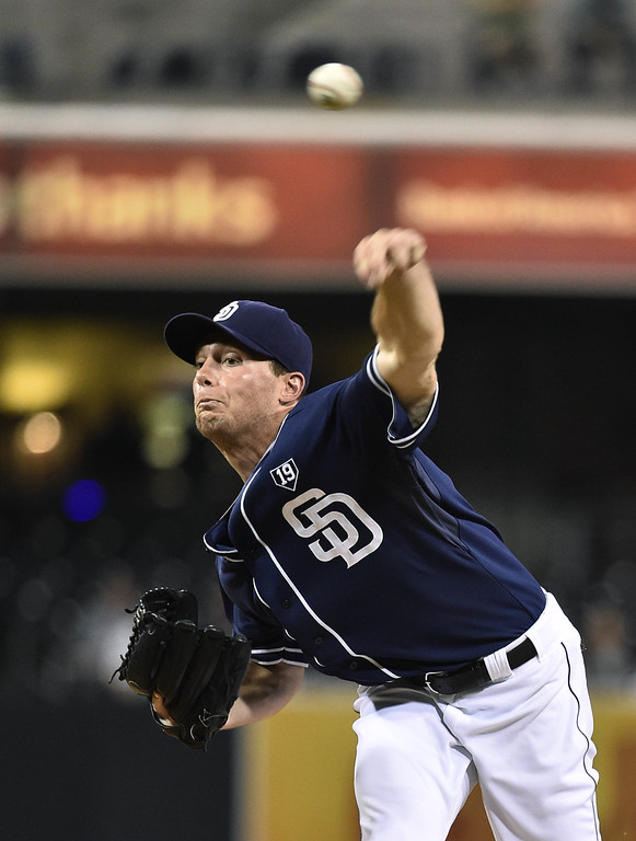 . SAN DIEGO, CA - SEPTEMBER 23:  Robbie Erlin #41 of the San Diego Padres pitches during the first inning of a baseball game against the Colorado Rockies at Petco Park September, 23, 2014 in San Diego, California.  (Photo by Denis Poroy/Getty Images)