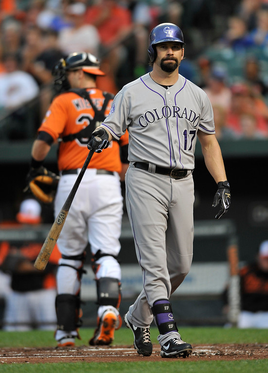 . Colorado Rockies\' Todd Helton reacts after striking out with two on against the Baltimore Orioles in the first inning of a baseball game on Saturday, Aug. 17, 2013, in Baltimore. The Orioles won 8-4. (AP Photo/Gail Burton)