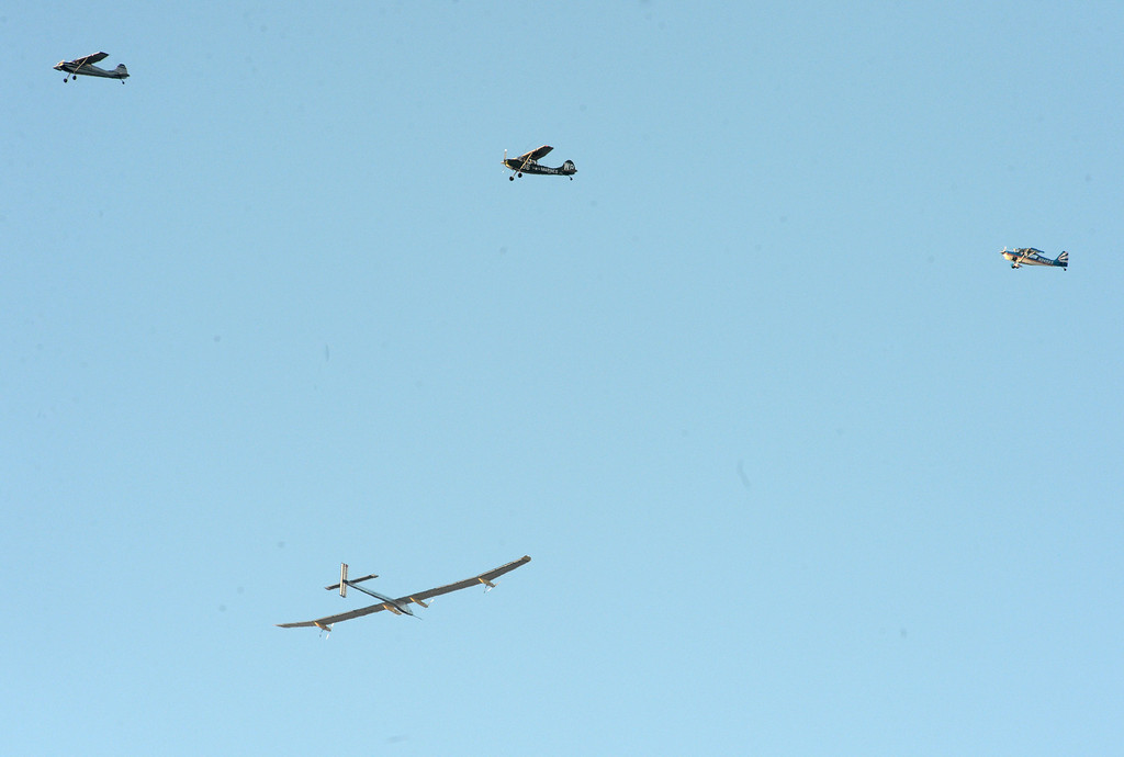 . Three planes fly near the solar driven airplane Solar Impulse as it flies over the San Francisco Bay on Tuesday, April 23, 2013. (Doug Duran/Bay Area News Group)