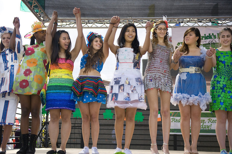 . College students model environmental clothing constructed from recyclables including dental Xrays, VCR tapes, beer tabs and shopping bags at the 7th Annual St. Patrick\'s Day Celebration & Green Festival, Sunday, March 17, 2013 at the Orange County Market Place in Costa Mesa, Calif. (AP Photo/The Orange County Register, Mindy Schauer)