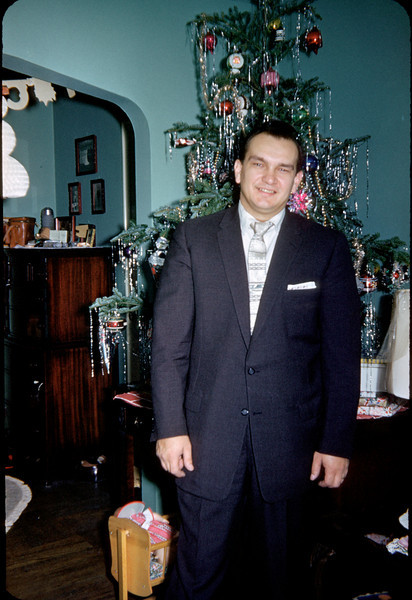 daddy in suit with christmas tree.jpg