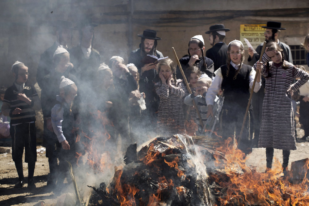 . Ultra-Orthodox Jews burn leavened items in a final preparation before the start at sundown of the Jewish Pesach (Passover) holiday, on March 25, 2013 in Jerusalem. Religious Jews worldwide eat matzoth during the eight-day Pesach holiday that commemorates the Israelis\' exodus from Egypt some 3,500 years ago and their ancestors\' plight by refraining from eating leavened food products. MENAHEM KAHANA/AFP/Getty Images