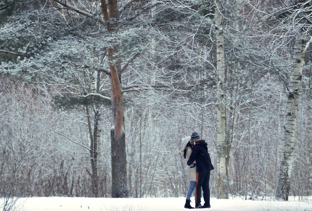 . A couple share a tender moment in a snowbound park in St. Petersburg, Russia, Monday, Jan. 9, 2017. The temperature in St. Petersburg is 0 degress Centigrade (32 degrees Fahrenheit). (AP Photo/Dmitri Lovetsky)