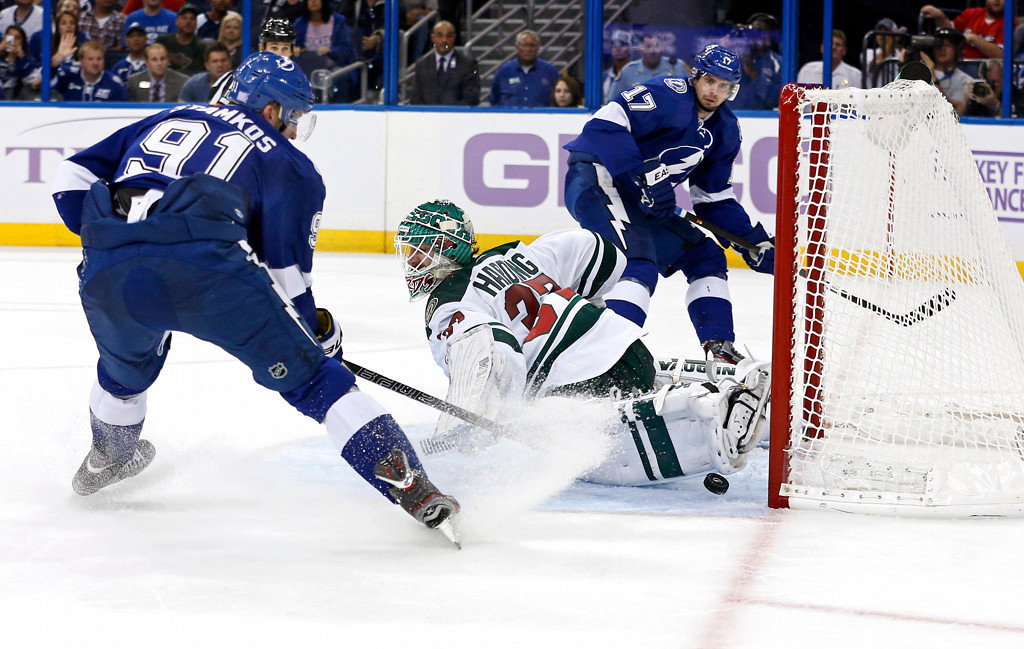 . Goalie Josh Harding #37 of the Minnesota Wild makes a save on a shot from Steven Stamkos #91 of the Tampa Bay Lightning on a pass from Alex Killorn. (Photo by Mike Carlson/Getty Images)