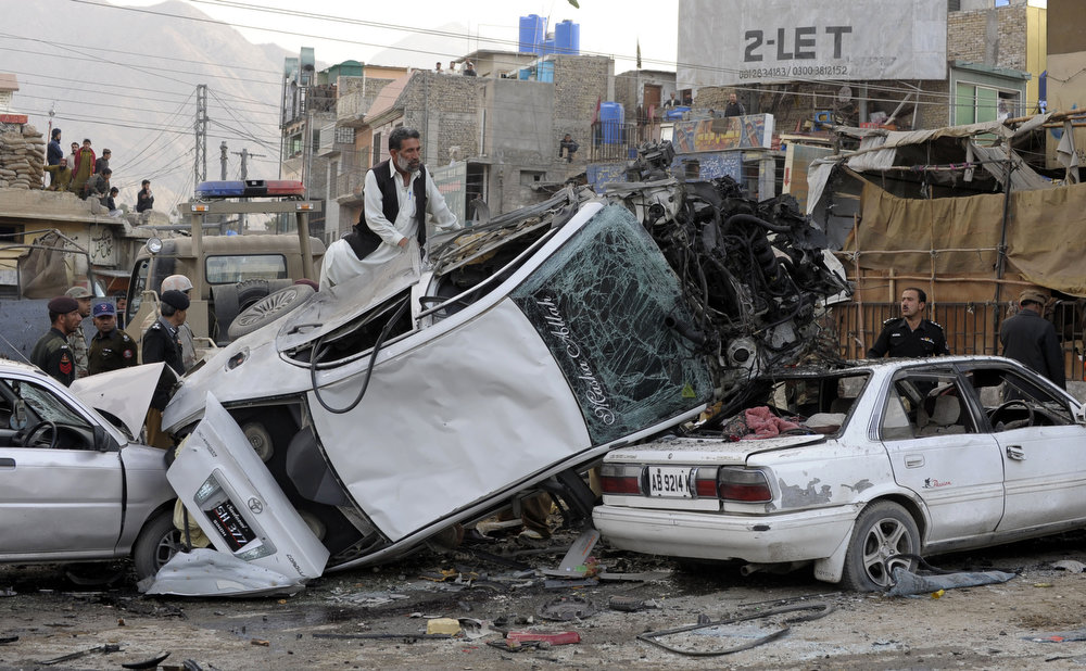 . Pakistani security personnel search the wreckage of vehicles after a bomb explosion in Quetta on January 10, 2013. A bomb attack killed 11 people and wounded dozens more in a crowded part of Pakistan\'s southwestern city of Quetta, police said. AFP PHOTO/Banaras  KHAN/AFP/Getty Images