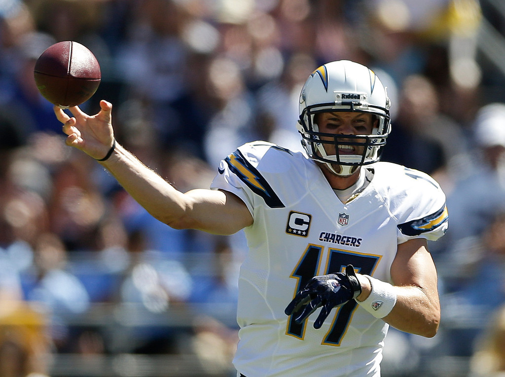 . San Diego Chargers quarterback Philip Rivers passes against the Dallas Cowboys during the first half of an NFL football game Sunday, Sept. 29, 2013, in San Diego. (AP Photo/Gregory Bull)