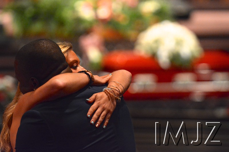 Mourners comfort each other before the funeral of former UofL Cheerleader Shanae Moorman at Canaan Christian Church Saturday morning. August 13, 2016.