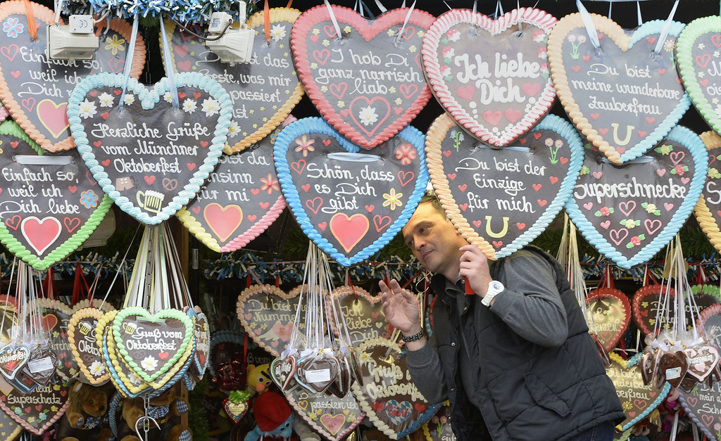 . A vendor displays his selection of heart-shaped gingerbread prior to the opening of the Bavarian Oktoberfest beer festival at the Theresienwiese in Munich, southern Germany, on September 21, 2013. The world\'s biggest beer festival Oktoberfest will run until October 6, 2013.  AFP PHOTO / CHRISTOF  STACHE/AFP/Getty Images