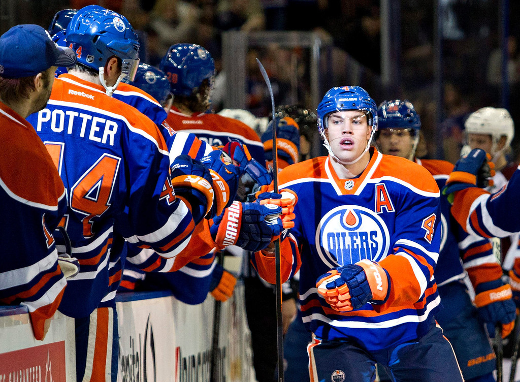 . Edmonton Oilers\' Taylor Hall (4) celebrates a goal with teammates against the Colorado Avalanche during first-period NHL hockey game action in Edmonton, Alberta, Thursday, Dec. 5, 2013. (AP Photo/The Canadian Press, Jason Franson)