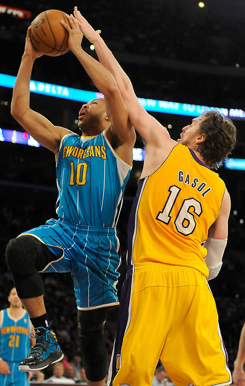 . Hornets#10 Eric Gordon drives the lane against Lakers#16 Pau Gasol in the second half. The Lakers played the New Orleans Hornets at Staples Center in Los Angeles CA 4/9/2013(John McCoy/Staff Photographer
