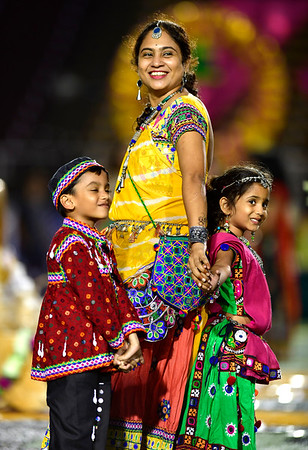 9/14/2019 Mike Orazzi | Staff Jigisha Badgujar her heir children Aarambh and Shree, during the Indian festival Navaratri held at Veterans Memorial Stadium in New Britain on Saturday night.