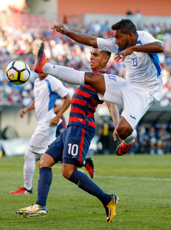 . Nicaragua\'s Bryan Garcia (13) makes a play on the ball against United States\' Joe Corona (10) during a CONCACAF Gold Cup soccer match in Cleveland, Ohio, Saturday, July 15, 2017. (AP Photo/Ron Schwane)
