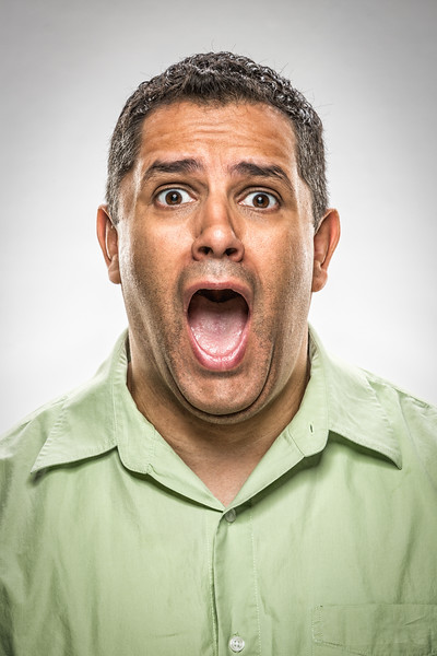 A funny face of a man with his mouth open.