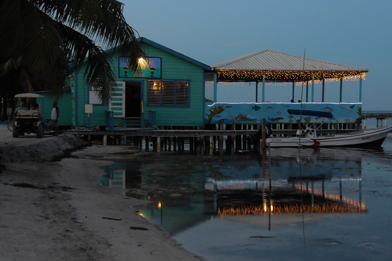 Colorful lights by the beach at night - Caye Caulker, Belize