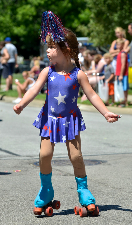 . Jeff Forman/JForman@News-Herald.com Reese Layto skates with the Mentor Artistic Skate Club in the Mentor Headlands July 4th Parade.