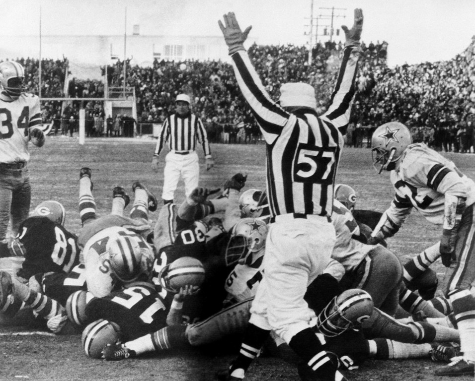 . Green Bay Packers quarterback Bart Starr (#15 at left) digs his face across the goal line to score the winning touchdown against the Dallas Cowboys to bring the Packers their third consecutive NFL championship, Dec. 31, 1967 in Green Bay, Wis. (AP Photo)
