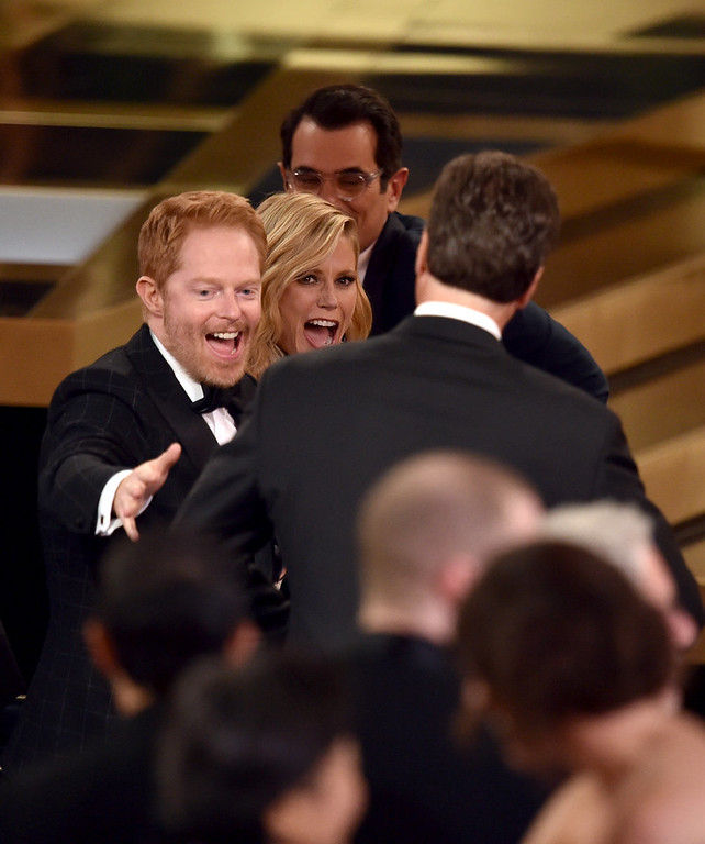 . Show creator Steven Levitan (R) with actors Jesse Tyler Ferguson, Julie Bowen and Ty Burrell accept Outstanding Comedy Series for \'Modern Family\' onstage at the 66th Annual Primetime Emmy Awards held at Nokia Theatre L.A. Live on August 25, 2014 in Los Angeles, California.  (Photo by Kevin Winter/Getty Images)