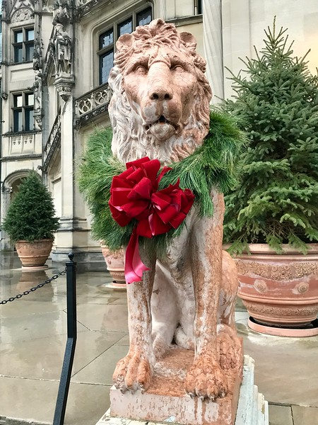 lion statue with big red bow