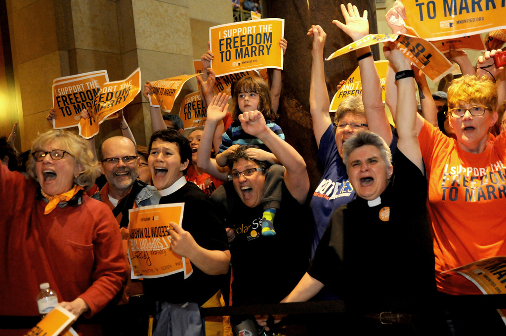 . People outside the Minnesota House of Representatives chambers, including two Episcopal priests, erupted in happiness when they got word that the bill allowing same-sex couples to get married passed at the state Capitol on Thursday.   (Pioneer Press: Jean Pieri)