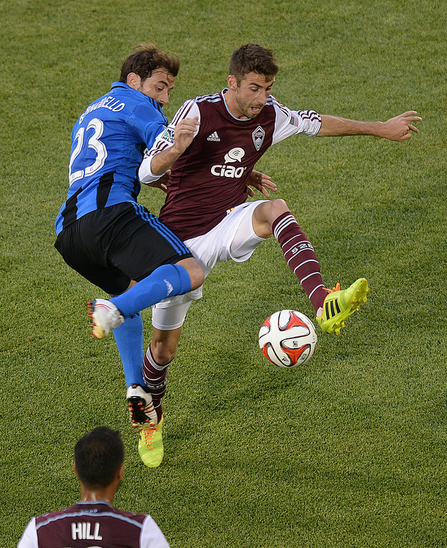 . Montreal defender Herman Bernardello (23) tried to stop Colorado midfielder Jose Mari (6) in the first half. The Colorado Rapids hosted the Montreal Impact Saturday night, May 24, 2014. (Photo by Karl Gehring/The Denver Post)