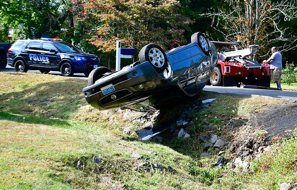 10/1/2019 Mike Orazzi   StaffrThe driver of this Nissan Altima escaped injury after a one vehicle crash near the intersection of Redstone Hill Road and Town Line Road on the Bristol, Southington, Plainville town lines on Tuesday afternoon. The driver was able to crawl out of the vehicle on her own and refused medical treatment at the scene.