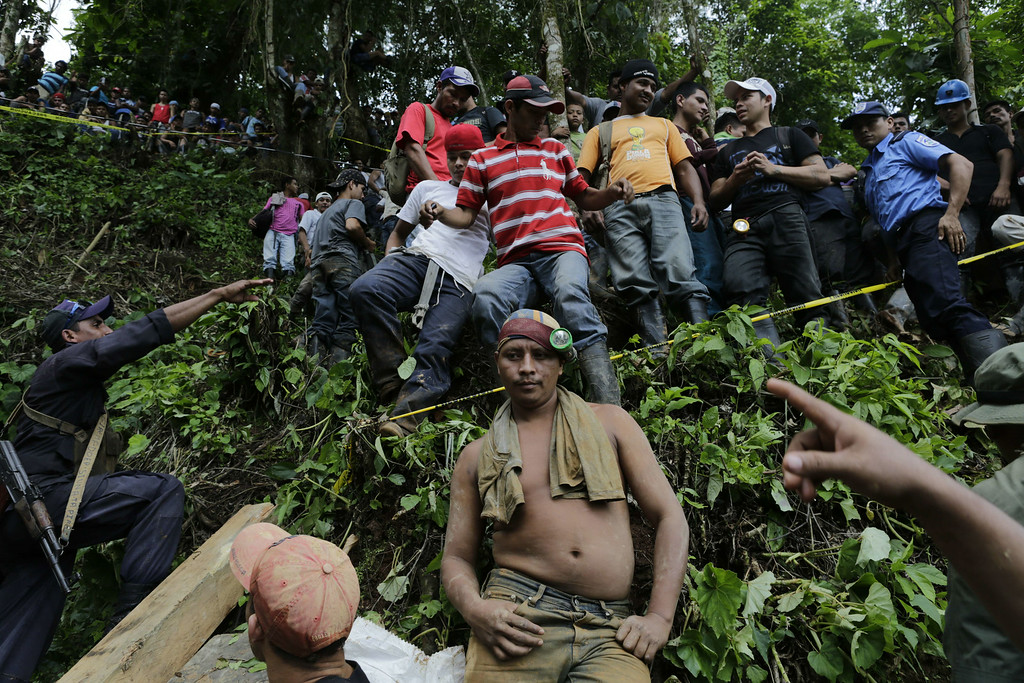 """. Relatives, friends and fellow miners wait as rescuers try to reach a group of miners trapped in a gold mine in the community of El Comal, near Bonanza in northeastern Nicaragua, on August 29, 2014. At least 20 miners are trapped alive deep underground after an informal gold mine collapsed in northeastern Nicaragua, presidential spokeswoman Rosario Murillo said Friday. \""""We have identified 20 comrades who are alive,\"""" Murillo said, adding there were 28 miners working in the shaft 800 meters (2,600 feet) underground when the cave-in happened Thursday. Two miners have managed to dig their way out. Inti Ocon/AFP/Getty Images"""