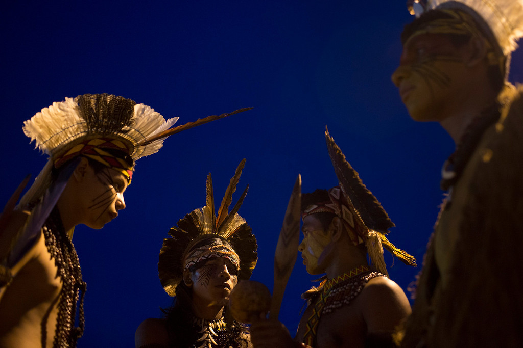 . Pataxo Indians gather during the indigenous games in Cuiaba, Brazil, Tuesday, Nov. 12, 2013. (AP Photo/Felipe Dana)