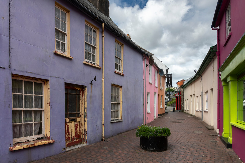 Residential buildings and stores amidst narrow lane of old town, Kinsale, County Cork, Ireland