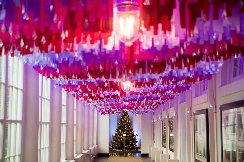 . More than 7,500 strands of colored ribbon hang with sparkling crystal ornaments on the East Colonnade of the White House during a preview of the 2016 holiday decor, Tuesday, Nov. 29, 2016, in Washington. (AP Photo/Andrew Harnik)
