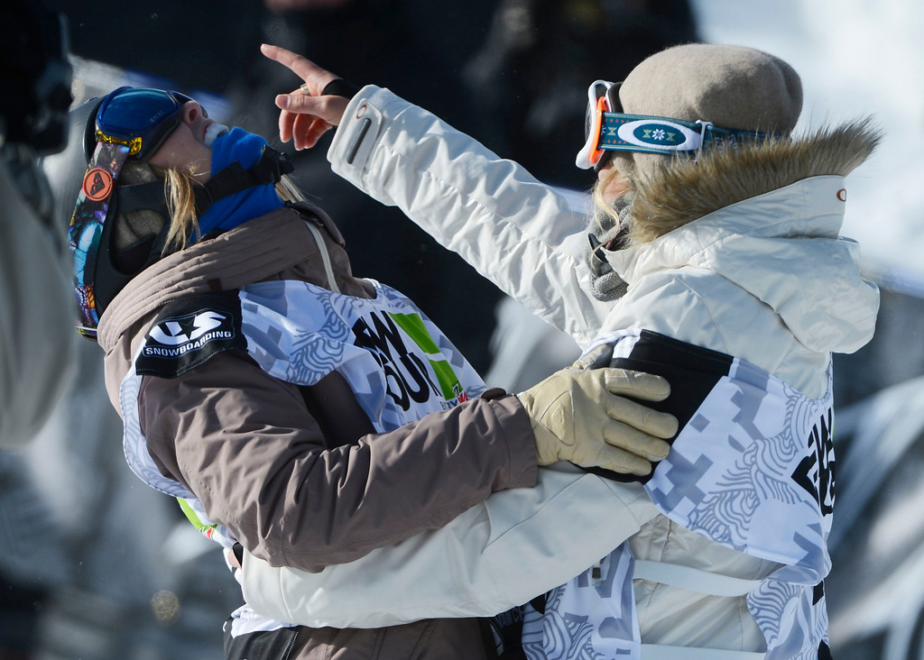 . Pro Snowboarder, Torah Bright, left, celebrates with fellow competitor, Gretchen Bleiler, right, after Bright\'s second run down the superpipe  at Breckenridge for the Dew Tour Ion Mountain superpipe championship finals at Breckenridge Saturday afternoon, December 14, 2013. Bright won the competition on her first run with a score of 95.40.  (Photo By Andy Cross/The Denver Post)