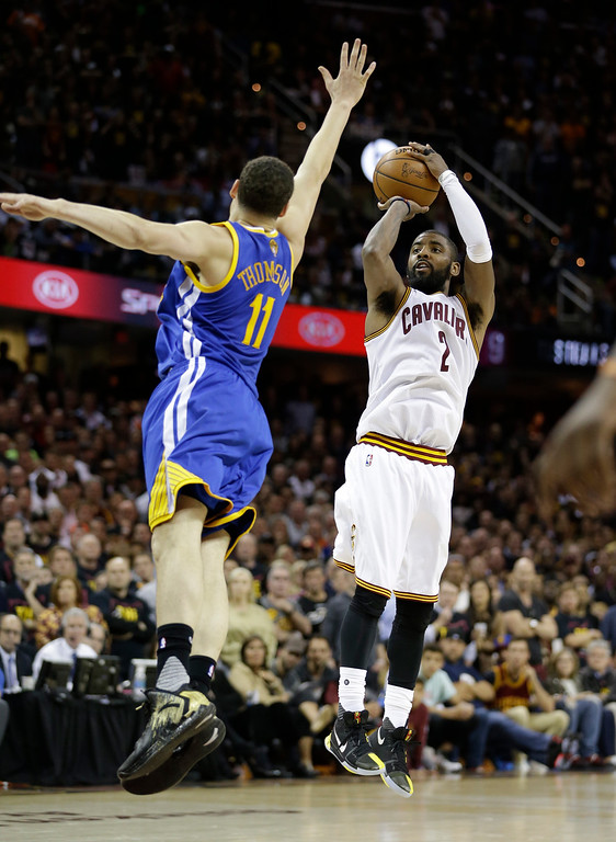 . Cleveland Cavaliers guard Kyrie Irving (2) shoots on Golden State Warriors guard Klay Thompson (11) during the second half of Game 3 of basketball\'s NBA Finals in Cleveland, Wednesday, June 7, 2017. (AP Photo/Tony Dejak)