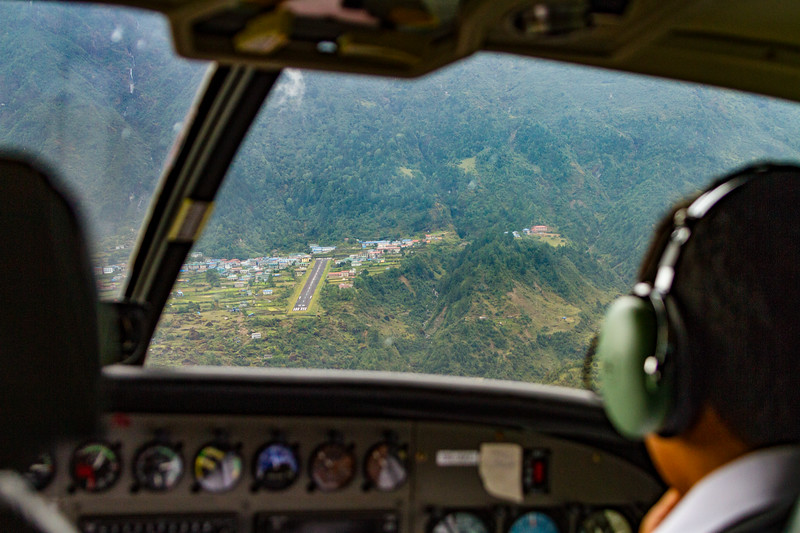 Cockpit view looking over pilot's shoulder on approach to Tenzing-Hillary (Lukla) Airport in Nepal's Himalayas